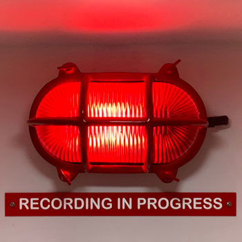 red recording studio light on air recording in progress